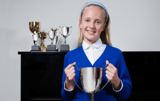 girl with trophy